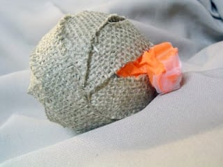 Make your own burlap decor ball with just scrap burlap, glue, and a balloon!  A quick and easy addition to your farmhouse decor!