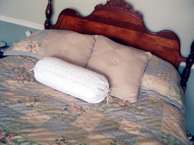 Recovering a bolster pillow is easier than you think! See how this blogger did it!