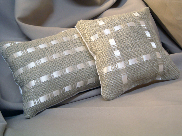 Make these burlap and ribbon pillows for your home with this craft tutorial.  A fun way to get the Pottery Barn look in your home!
