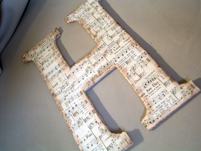 Make this sheet music letter with old cereal boxes! Step by step instructions for making your own DIY chipboard monogram!