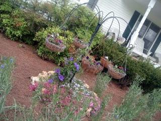 Turn old farm equipment into lawn art with this fun idea!