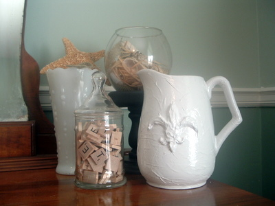 Emboss a pitcher with a hot glue gun to turn trash into treasure!