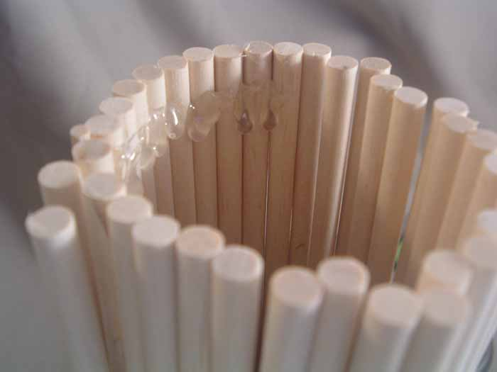 Make your own candlesticks using wood dowels and a few thiftstore finds! Gorgeous home decor for cheap!