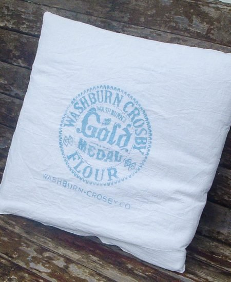 Gorgeous vintage grain sack pillows made with a logo cut into a stencil