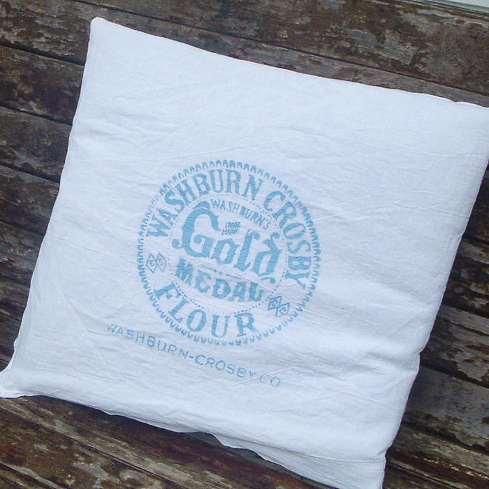 Gorgeous flour sack pillows with a vintage logo cut on the Cricut machine.
