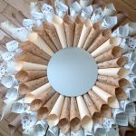 Use rolled vintage paper ephemera to create a one of a kind starburst mirror for any room!