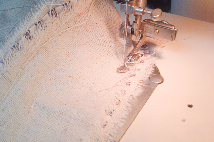 sewing cording on a pillow