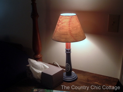 when you turn the lamp on the shade looks like a well worn baseball it is perfection for my rustic themed room i adore the lamp when it is on - Baseball Lamp