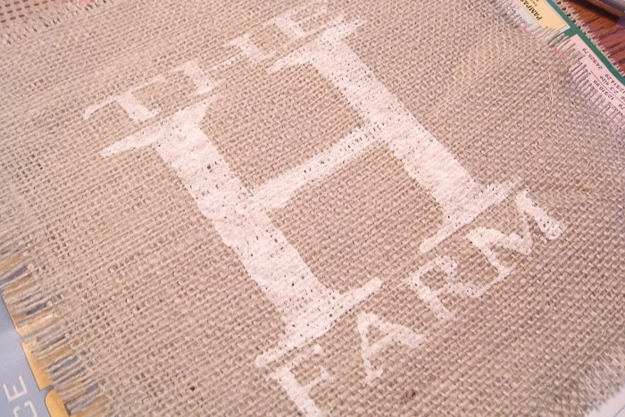 Use the stencil to paint your design onto your burlap sheet