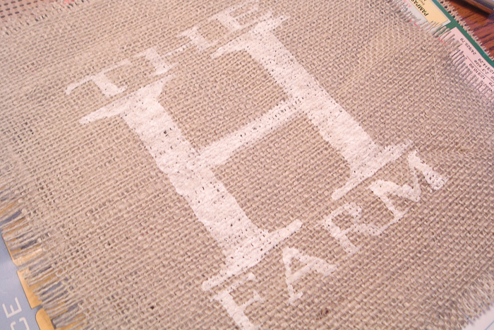 Painted farm logo on burlap