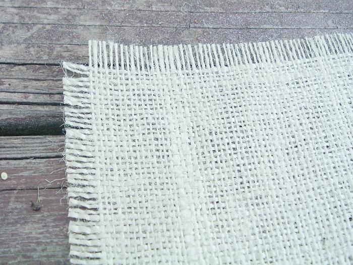 Frayed edges on burlap.