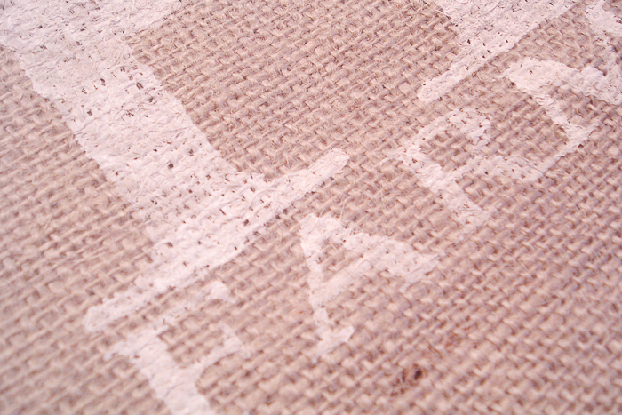 Touch up imperfections on the burlap using a small brush and paint
