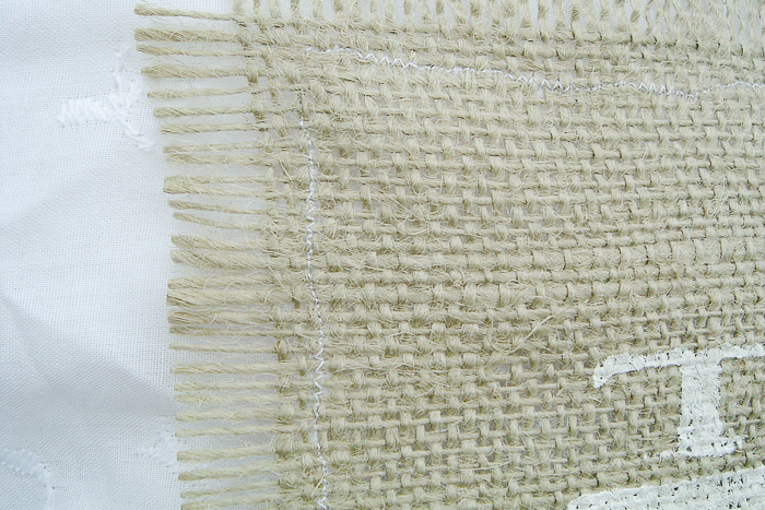 A straight stitch along the outside of the frayed burlap will be enough to secure the burlap to the lace