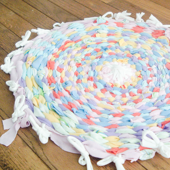 this rag rug is made with a hula hoop and old t-shirts