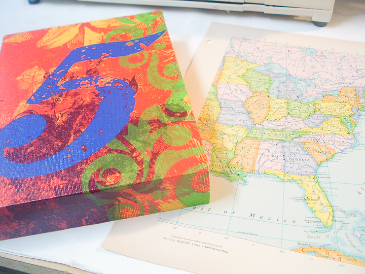 supplies for map craft with vintage maps