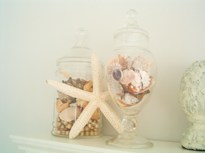 Seashells in jars in a beach theme bathroom.