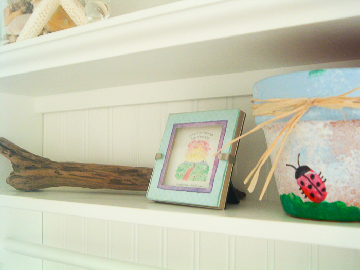 Decorating a theme bathroom with beach decor as well as personal touches.