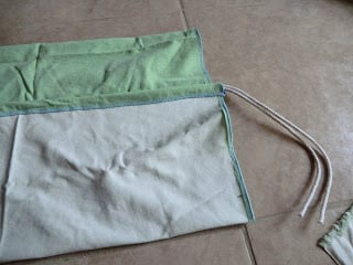 Fold the fabric over the rope and prepare to sew this section closed