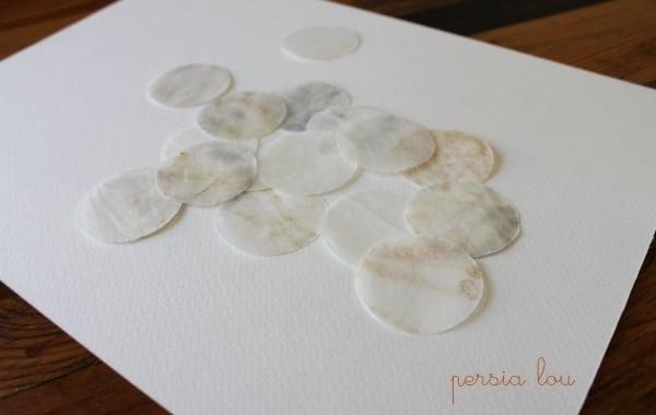 faux capiz shells on a piece of paper