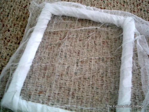covering a frame in cheesecloth for halloween