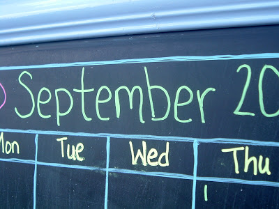 Use chalk markers to draw your calendar and any decorations on the chalkboard