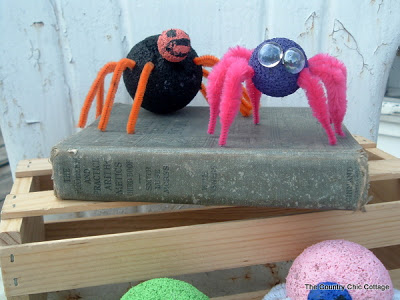 2 spider crafts sitting on a book