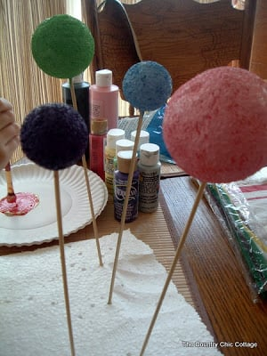 painted styrofoam balls on a stick