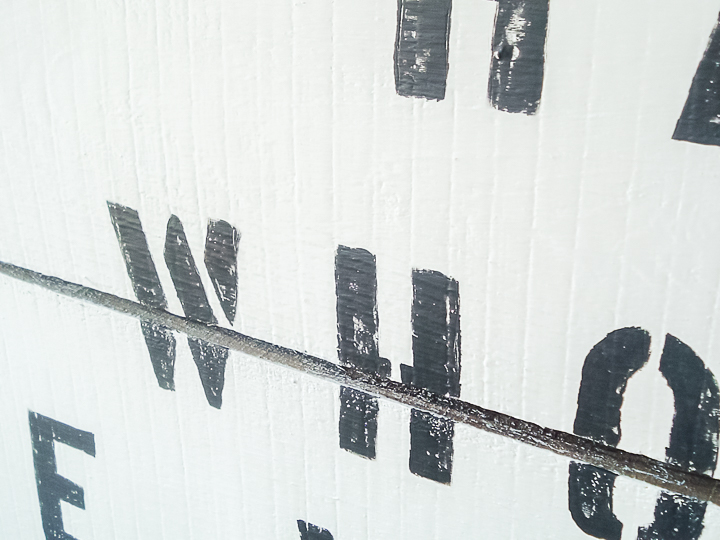 black letters on a white sign