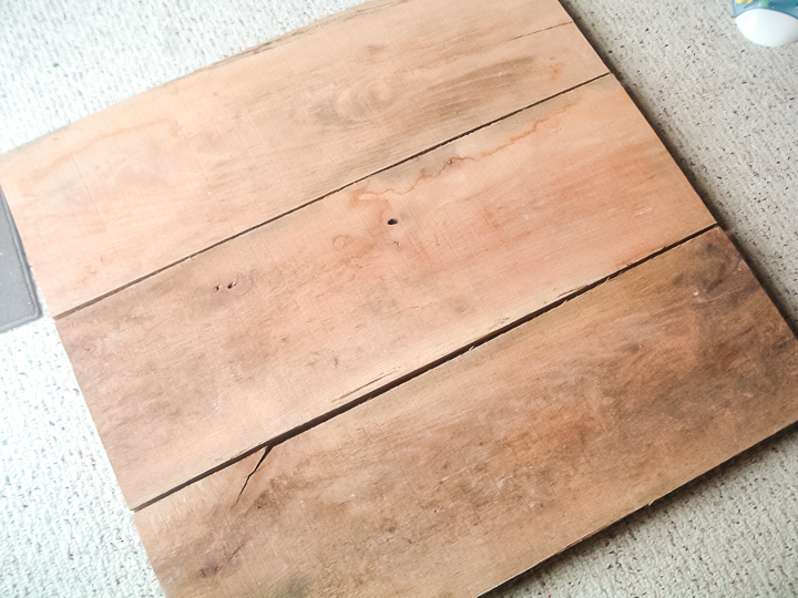 rough lumber made into a sign