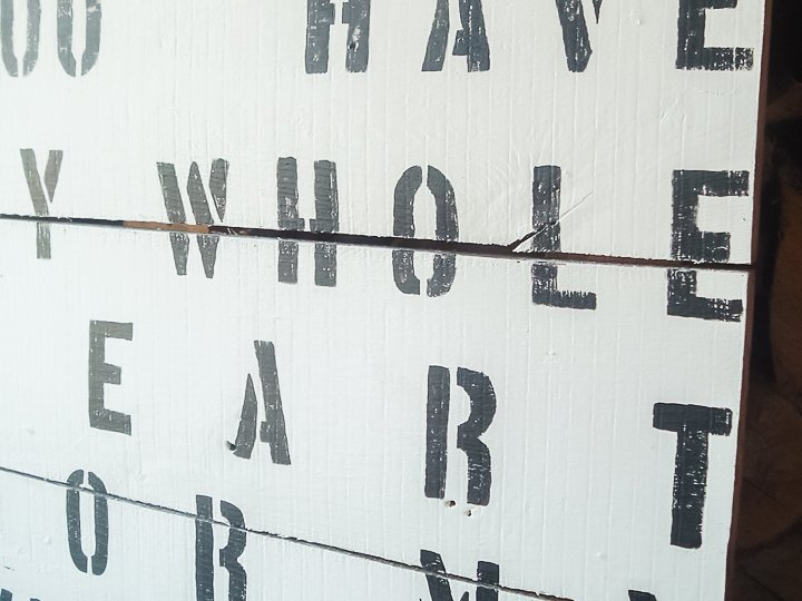 painting rustic letters on a wood sign