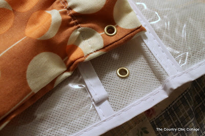 Grommets applied to shoe organizer and fabric