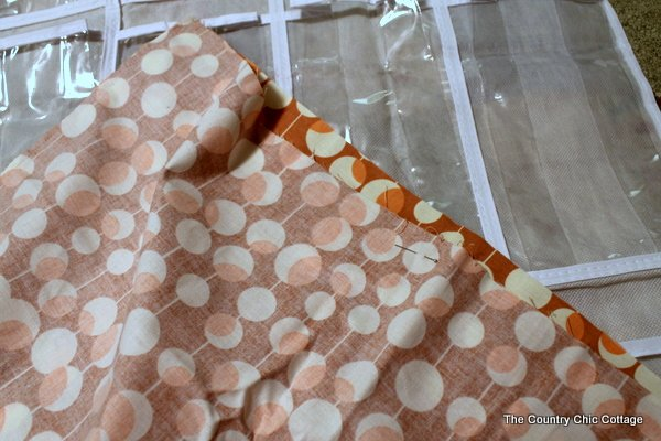 fabric pinned to create finished edge