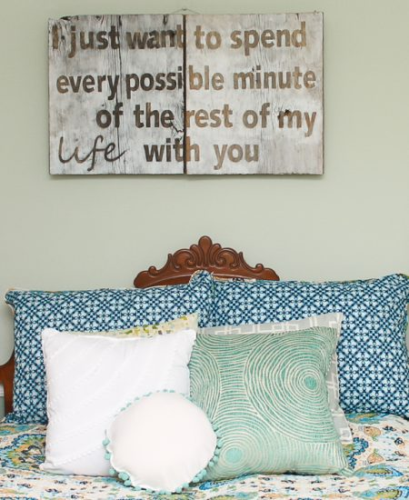 A bed with a blue background
