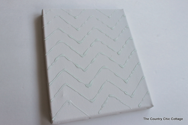 adding glue to a canvas