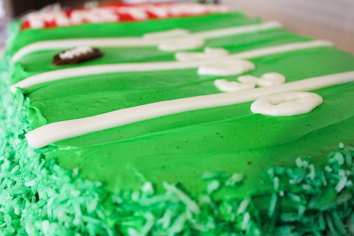 green coconut on a football cake