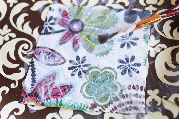 Adding Mod Podge to the front of fabric square