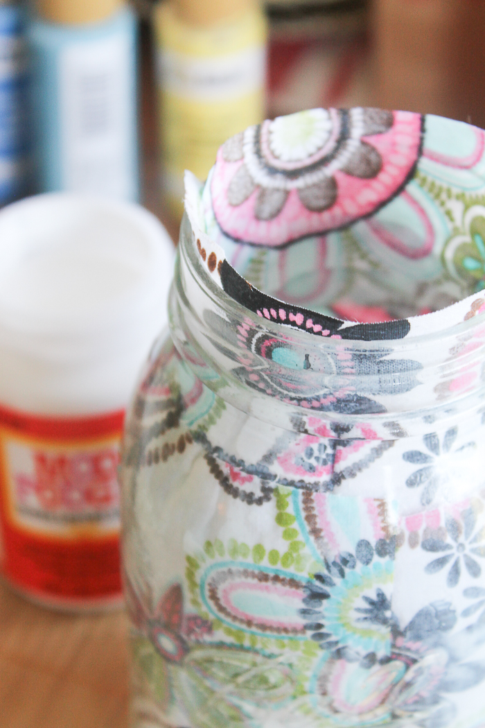 It's okay of the fabric comes up over the edge of the mason jar--you can trim that down once dry!