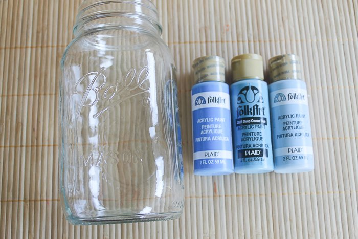 For this blue ombre mason jar, you need one large mason jar and 3 shades of acrylic blue paint