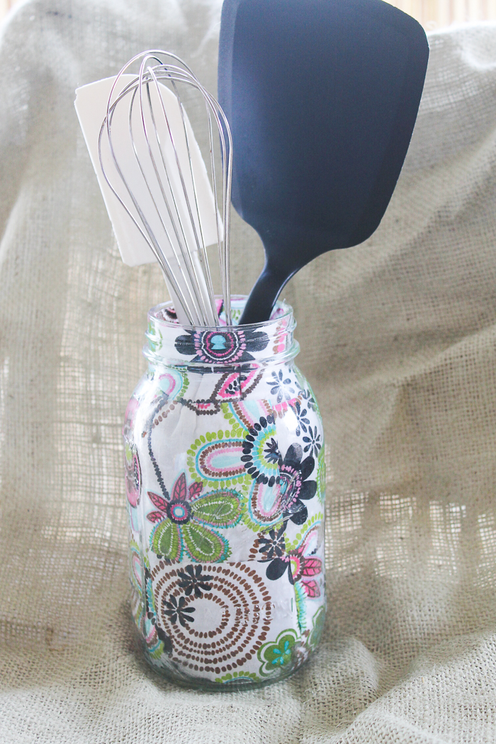 This groovy floral patterned fabric is decoupaged on the inside of the mason jar