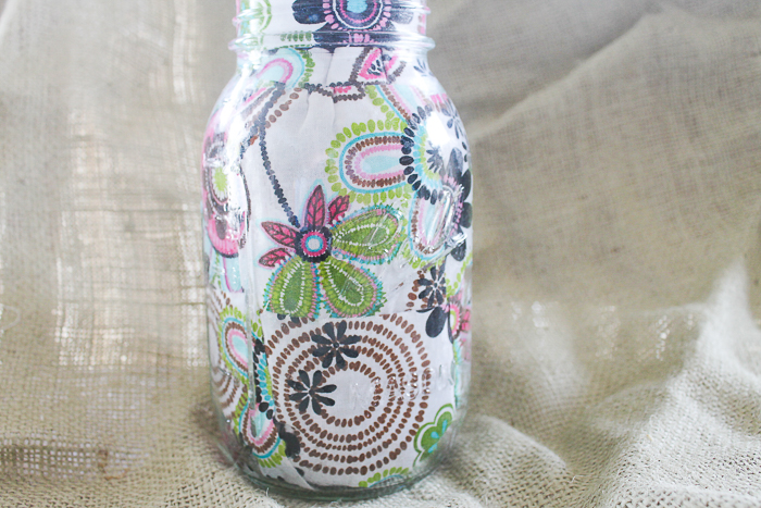 This floral decoupaged mason jar is perfect for storage of any kind!