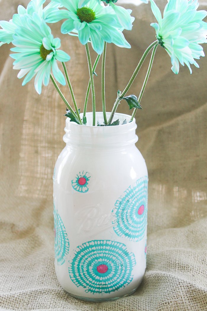 This springy mason jar uses both paint and decoupaged fabric