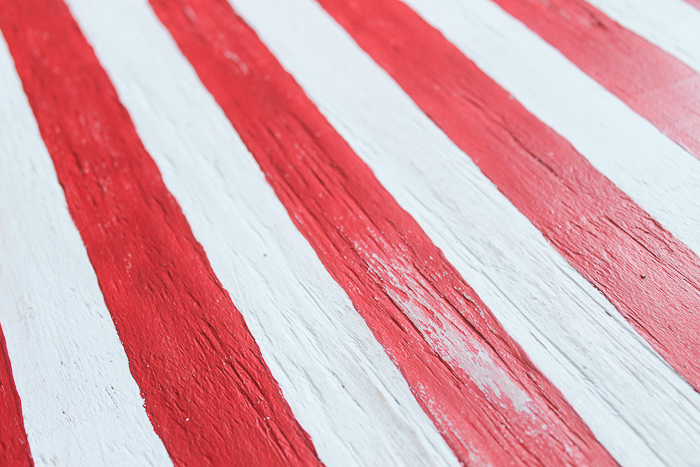 Use sandpaper to distress painted wooden American flag
