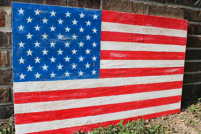 A completed wooden American flag made from scrap plywood.