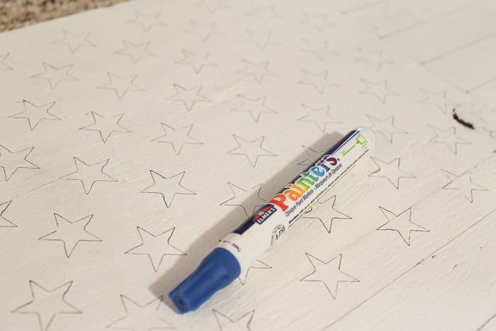 using a paint pen on a stencil will help make perfect stars for your American Flag decor!