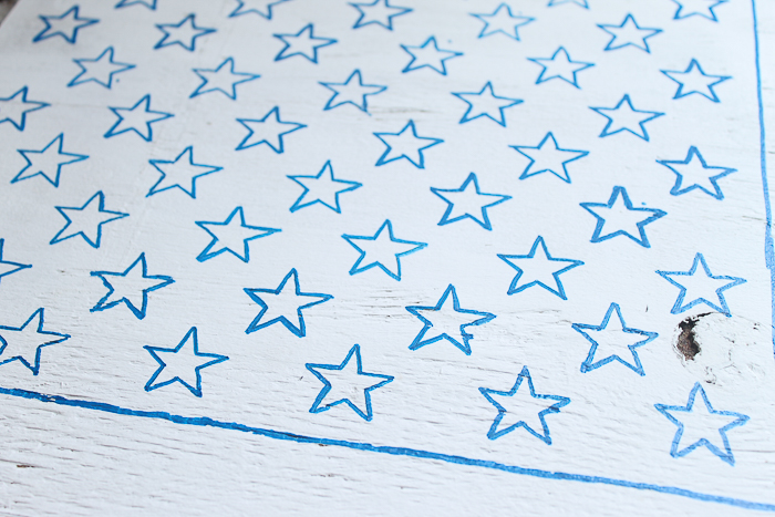 stars outlined with a paint pen, ready to be filled in with blue paint