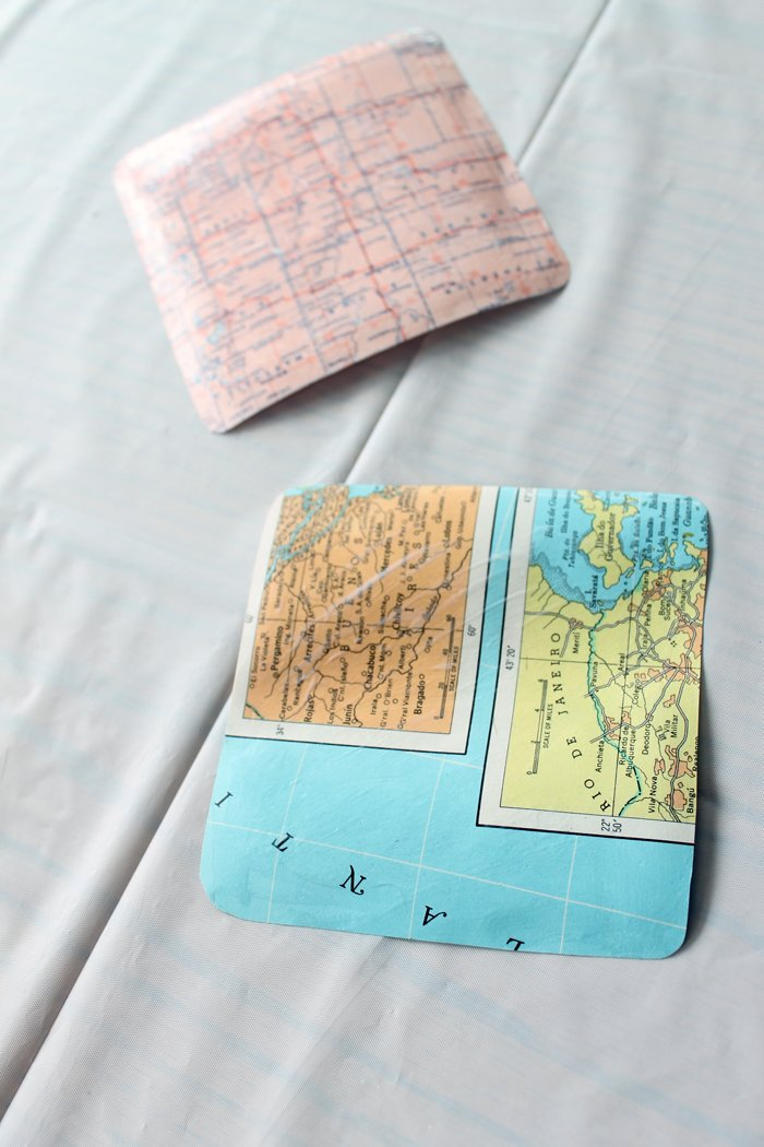 Allow your DIY map coasters to cure and they are ready to be used in any room of your home. Make as many of these as you would like. They are the perfect coasters for entertaining or daily use. Change up the color to match your decor and pick maps of places that are meaningful to your family.