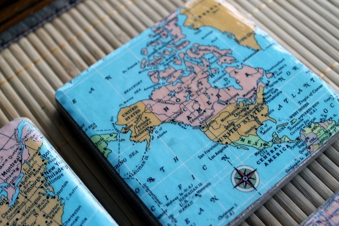 DIY map coasters, use old ordanance survey maps of your neighbourhood and you will have an interesting set of mats as gifts or keepers. easy diy gifts for him- use maps and modge podge to make coasters. (get maps from our favorite places and trips) DIY Map Coasters - .