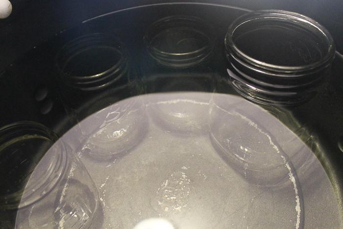mason jars in pot of water