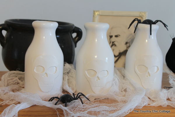 spray painting skull vase for halloween