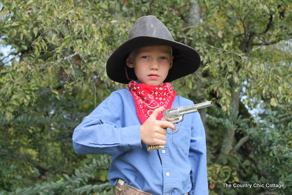 This cowboy halloween costume was put together with thrift store finds